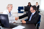 Physician shaking hands with Hospital Executive