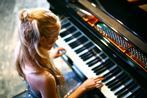Woman playing grande piano